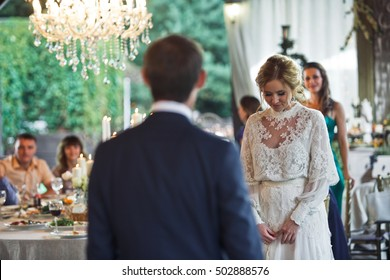 Bride looks shy waiting for a groom to dance