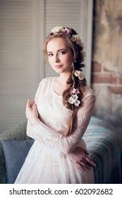 Bride in a luxurious apartment in a wedding dress.
