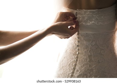 the bride is made to wear a wedding dress