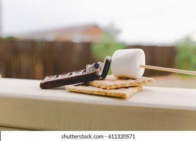 Bride Makes Wedding Reception Smore with Marshmellos Wedding Rings