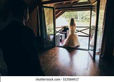 bride on the balcony in the hotel room
