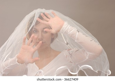 bride on gray background close-up