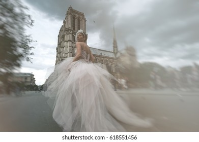 Bride is on the run through the streets of Paris, with a stylish dress