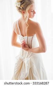 Bride opening her dress