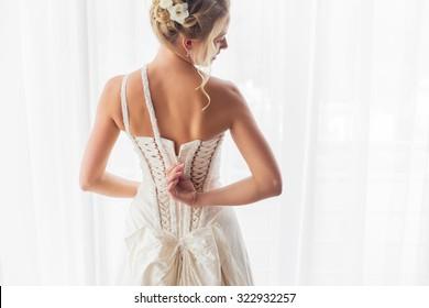 Bride opening her wedding dress