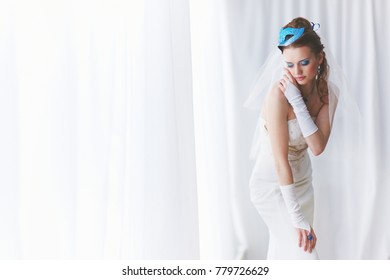 Bride in original MUAH with carnival mask