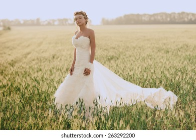 Bride at outdoor in a morning surrounding by golden sunlight