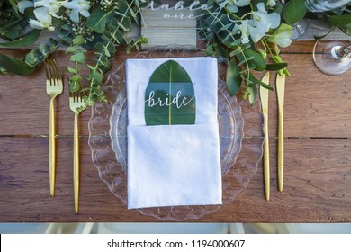 Bride Place Card Dried Leaf Romantic Wedding Table Top Layout Table Spread no people no human tropical location with gold cutlery and scenic view leaves and leaf