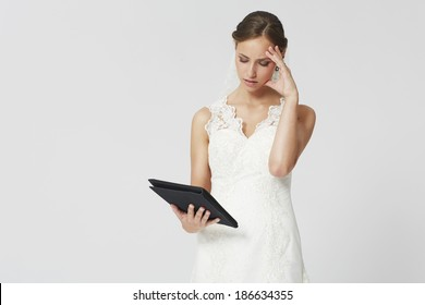 Bride planning her wedding with a tablet