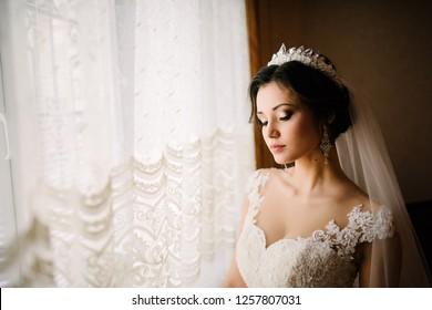 Bride posing in a lush white dress