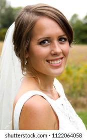Bride posing outdoors