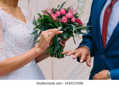 The bride puts a gold ring on her husband's finger. Happiness to marry a loved one, happiness in marriage. Official registration of marriage in the registry office.