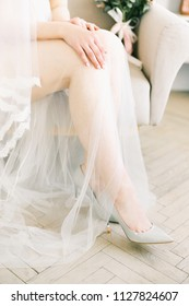 The bride is putting her shoes on. Wedding day. Morning of the bride. Wedding bride shoes