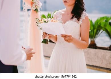 bride reading wedding vows. Wedding ceremony