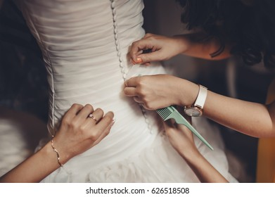 bride in a rush of getting ready for a wedding