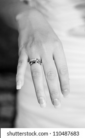 Bride showing engagement and wedding ring