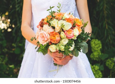 Bride showing off her beautiful bouquet of flowers