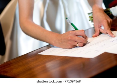 Bride signing engagement agreement