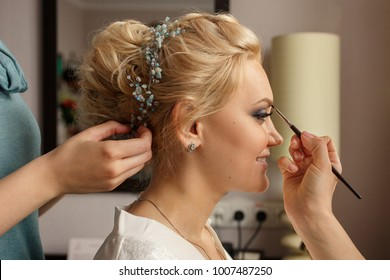 Bride with smoky eyes. Wedding makeup. Makeup artist made makeup for beautiful bride at wedding day