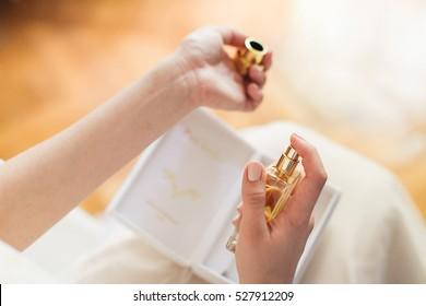 Bride spraying perfume. Bride applying perfume on her wrist.