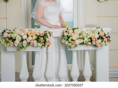 the bride is standing on the balcony