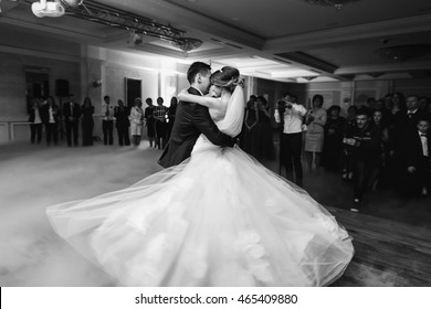 Bride swirls around the fiance in a dance