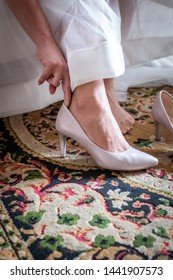 Bride taking wedding shoes for wedding. closeup of bridal shoes