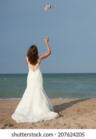 Bride throwing shoes air