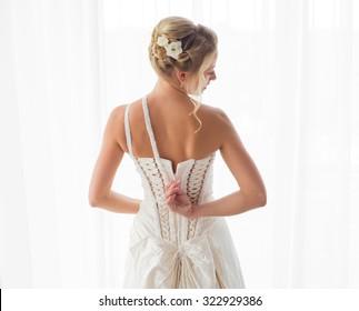 Bride unzipping her dress