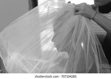 bride in veil, wedding preparations