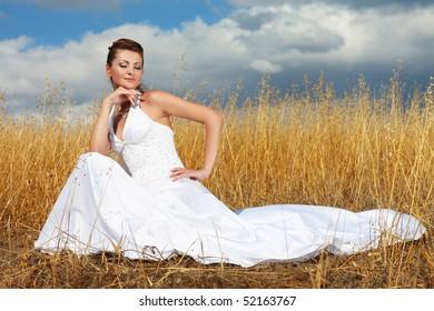 Bride to walk in a field