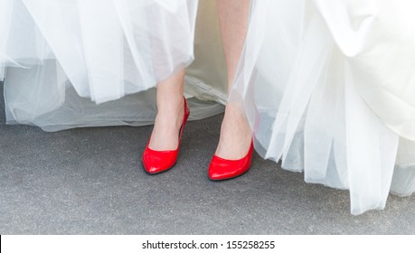 Bride Wearing Red Shoes