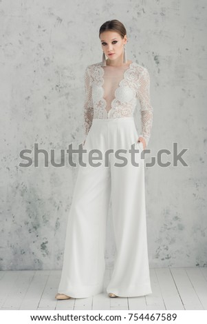 fe310dbe0fe6 Bride Wearing Wedding Trouser Suit Stock Photo (Edit Now) 754467589 ...
