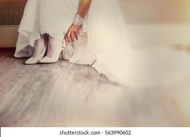 Bride wearing white wedding dress and shoes