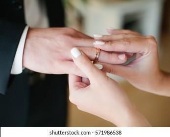 bride wears ring on groom's finger