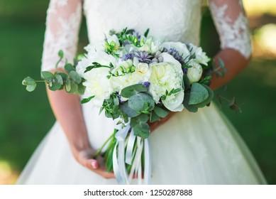 Bride with wedding bouquet.