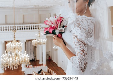 Bride with wedding bouquet with callas and orchids