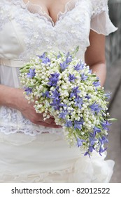 bride with wedding bouquet made from lily of the valley