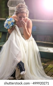 Bride at wedding day with wrong shoes in the park
