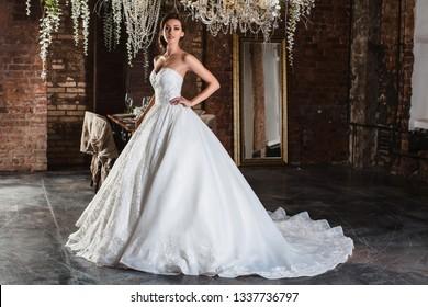 Bride in a wedding dress. In the flower interior