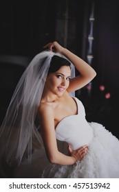bride in wedding dress getting ready for wedding