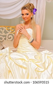 The bride in a wedding dress  with glass of champagne in the luxuriant interior.