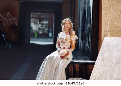 Bride in a wedding dress. Happy bride posing