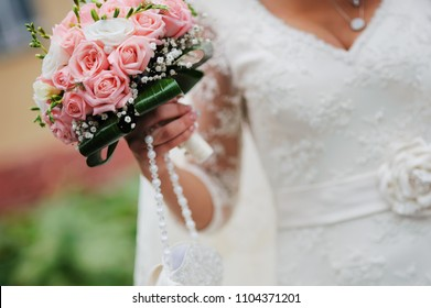 Bride in a wedding dress posing