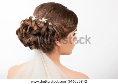 bride with wedding hairstyle and veil on a white background