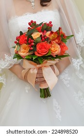The bride at the wedding is holding a bouquet of flowers