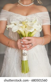 The bride at a wedding holding a bouquet of flowers