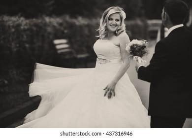 Bride whirls standing behind a groom