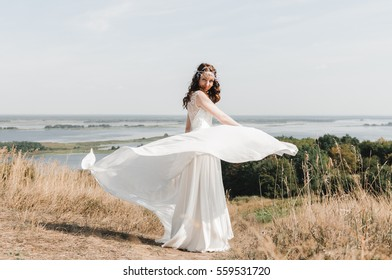 The bride in a white dress, bridesmaid dress