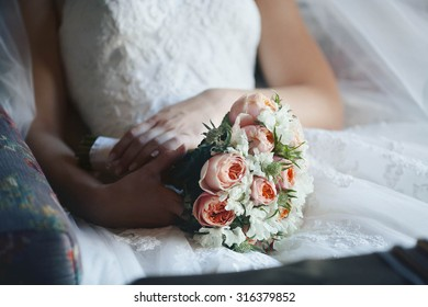 bride in a white dress holding a bouquet of gorgeous flowers